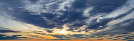 Background panorama dark dramatic clouds sunset. Dark dramatic clouds at sunset. sky background panorama Royalty Free Stock Image