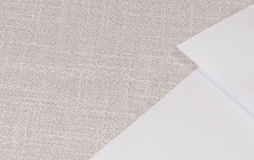 Background: paper on cloth. A design background with two white sheets of paper on a beige cotton fabric Stock Image
