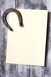 Background is paper and horseshoes Royalty Free Stock Photo