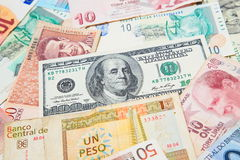 Background from paper money of the different countries. American dollars in the middle Royalty Free Stock Images
