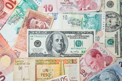 Background from paper money of the different countries. American dollars in the middle Stock Photography