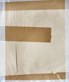 Background with paper texture and stick tape of brown color Royalty Free Stock Images