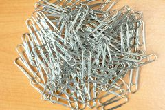 Paperclip. Background  paperclip on wooden desk Royalty Free Stock Photography