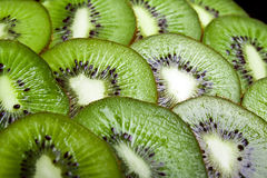 Background of part of kiwi by rings. Royalty Free Stock Photography