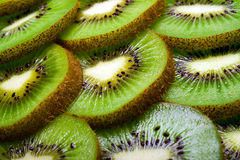 Background of part of kiwi by rings. Stock Image
