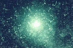 Background with the particles. Beautiful green background with optical flare for your design royalty free illustration