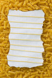 Background, pasta sheet line. Background of dry pasta with a note for the recipe Royalty Free Stock Image