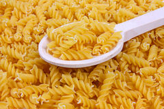 Background of pasta and a wooden spoon Royalty Free Stock Image