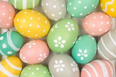 Background of pastel, hand painted Easter eggs Stock Photo
