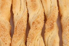 Background of pastry sticks. With sesame seeds Stock Image