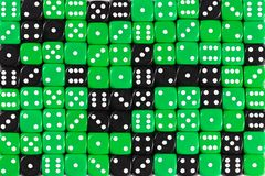 Background patteren of random ordered green and black dices royalty free stock images