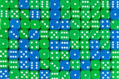 Background patteren of random ordered green and blue dices. Pattern background with two-third random ordered green dices and one-third blue dices royalty free stock images