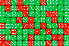 Background patteren of random ordered green and red dices stock photos