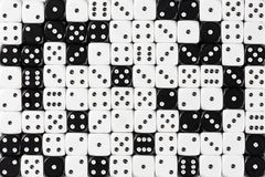 Background patteren of random ordered white and black dices stock photo