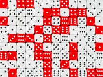 Background patteren of random ordered white and red dices stock photography