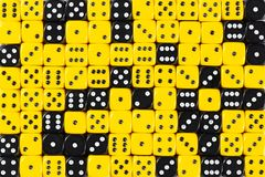 Background patteren of random ordered yellow and black dices stock photography