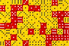 Background patteren of random ordered yellow and red dices. Pattern background with two-third random ordered yellow dices and one-third red dices stock images