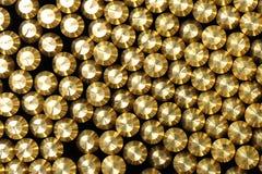 Background pattern of bevelled brass rods. Background pattern of the ends of shiny bevelled brass rods stock photography