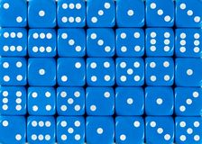 Background pattern of blue dices, random ordered stock photography