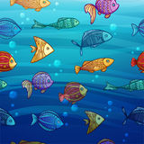 Background with a pattern of colored cartoon fish Royalty Free Stock Photo