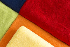 Background pattern of colorful towels. Background geometric pattern of colorful towels in the colors of the rainbow neatly arranged with abutting edges and a Stock Images