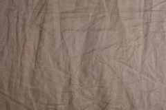 Background Pattern of Crumpled Brown Textile Texture Stock Photography