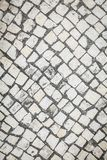 Background with pattern of old paving stone top view.  royalty free stock image