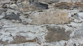 Background of pattern of old stones and loam stock photo