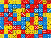 Background pattern of random ordered red, blue and yellow dices stock photo