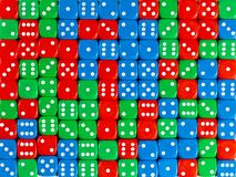 Background pattern of random ordered red, green and blue dices stock photography