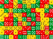 Background pattern of random ordered red, green and yellow dices. Pattern background of random ordered red, green and yellow dices stock photography