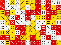 Background pattern of random ordered white, red and yellow dices. Pattern background of random ordered white, red and yellow dices stock image