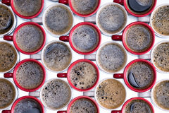 Background pattern of red and white coffee mugs Stock Photography