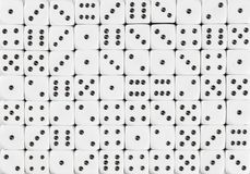 Background pattern of 70 white dices, random ordered stock image
