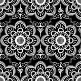 Background pattern with white mehndi seamless lace decoration items on black background. Royalty Free Stock Photography