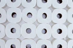 Background pattern of white toilet paper rolls. Full frame background pattern of white toilet paper rolls arranged in neat rows viewed from above - Toilet paper Royalty Free Stock Photos