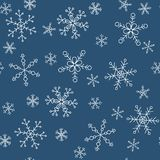 Snowflakes of different styles on a background of blue, pattern. The background pattern for winter themes. Snowflakes five styles, two groups of sizes. Color Stock Image