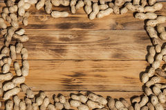 Background peanuts. Peanuts on a wood Background Royalty Free Stock Photo