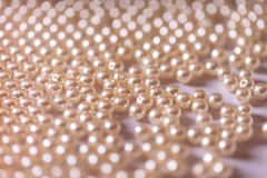 Background of pearl beads closeup. Royalty Free Stock Image