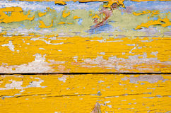 Background of peel retro grunge wooden wall planks. Background of peel retro vintage grunge wooden wall planks of building painted in yellow Stock Images