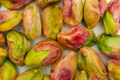 Background of peeled pistachio nuts Stock Images