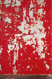 Background peeled red scarlet paint on the wall. Royalty Free Stock Photo