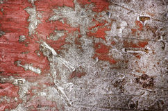 Background of peeling paint and rusty old red metal. Royalty Free Stock Photos