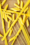 Background of penne and spaghetti on a wooden table.  Royalty Free Stock Photos
