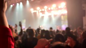 Background people acoustic stadium night music front holding hand up. asian crowd back adult woman man. Background view people in acoustic stadium night music stock footage