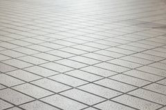 Perspective square pavement in light. Background of perspective pattern of square pavement street floor, shadow depth of field Stock Images