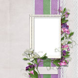 Background with photo frame and sweet peas Stock Photo