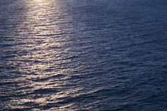 Background photo, sun glare on dark sea water Stock Photo