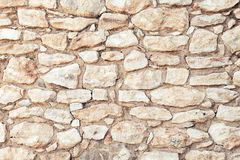 Background photo texture of yellow stone wall Royalty Free Stock Images