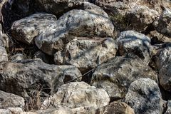Background. photograph of piles of stone collected and used in building either whole or as crushed rock. Background. photograph of piles of stone collected and stock image